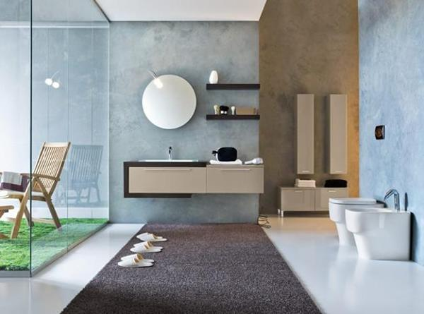 wood bathroom furniture and round wall mirror