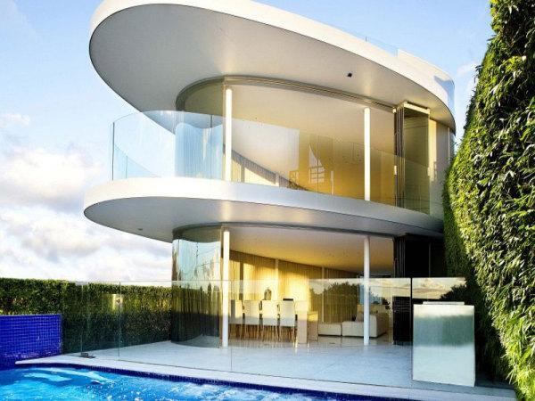 modern house with grall balconies and swimming pool