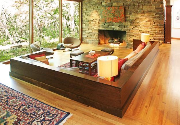Beau Sunken Living Room Design With Stone Fireplace And Large Windows