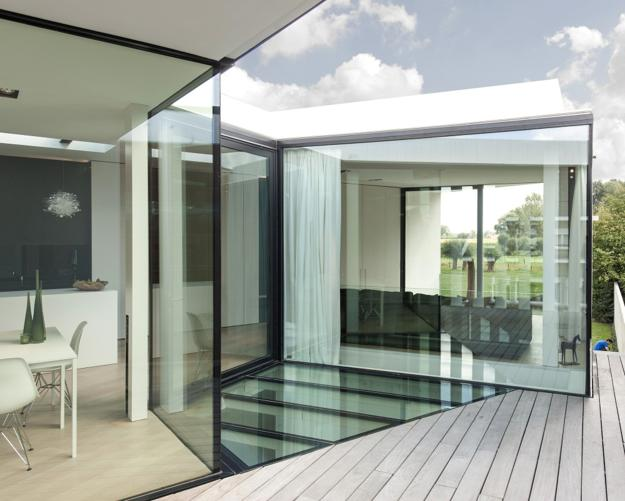 Glass Floor and Unusual Architecture Add Flair to Bright Small Home ...