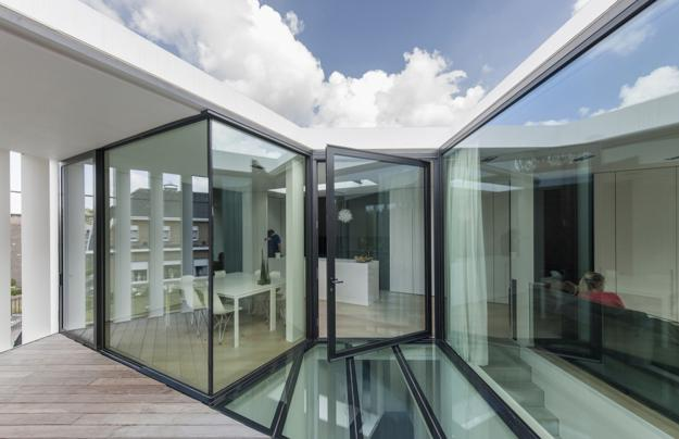 glass floor and unusual architecture add flair to bright small home