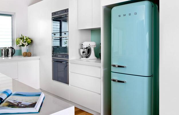 Light Blue Retro Fridge And White Kitchen Cabinets