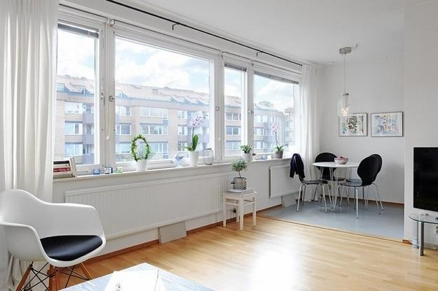 Studio Apartment With A Large Window And Modern Interior Decorating In Black White Room Colors
