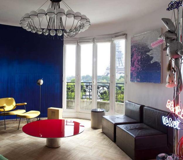 Living Room Design With Rich Blue Wall And Red And Yellow Furniture