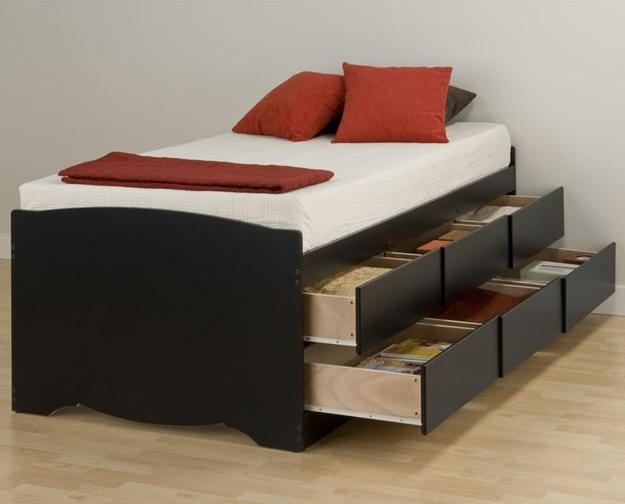 Large Bed With Lifted Parts And Storage Spaces Integrated Into Its Base