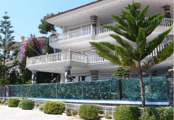 modern house with fence made with aquariums