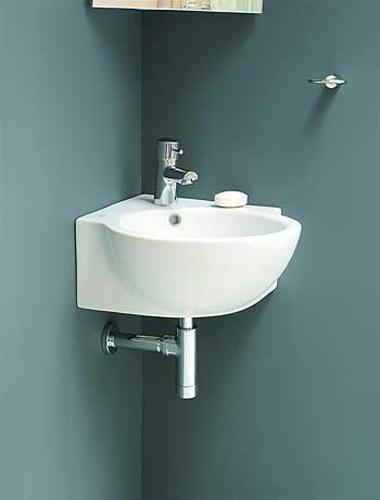 Corner bathroom sinks creating space saving modern for Small space bathroom