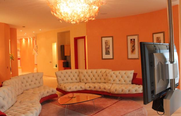 Living Room Design Orange Paint And Furniture