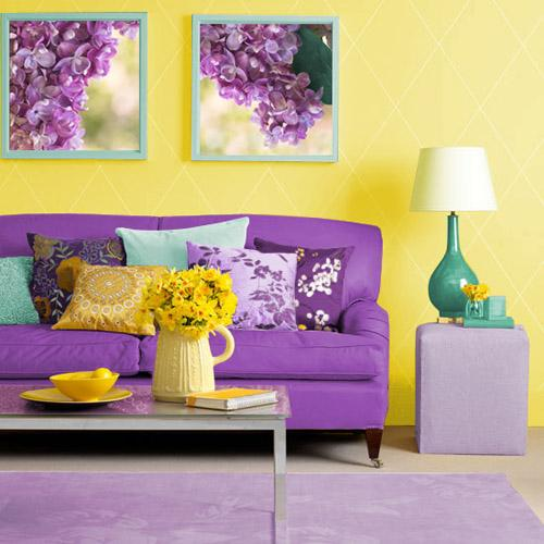 Yellow Wall Paint And Decorative Pillows, Purple Sofa Upholstery Fabric And  Wall Art With Purple Flowers