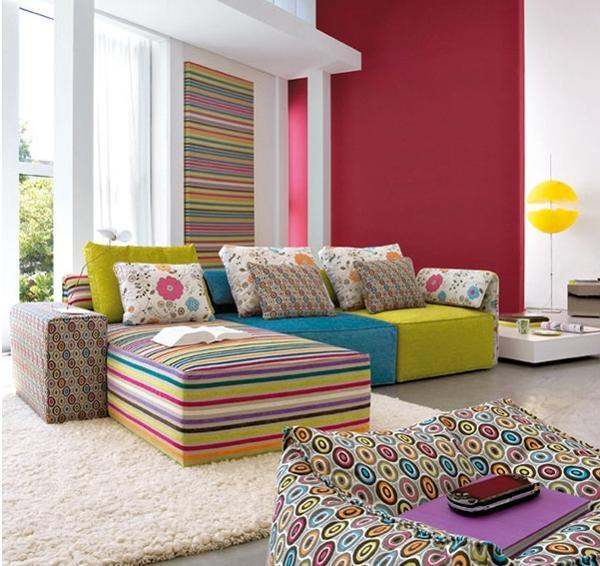 Modern Living Room Design With Reddish Pink Accent Wall, Colorful Furniture  And Decor Accessories
