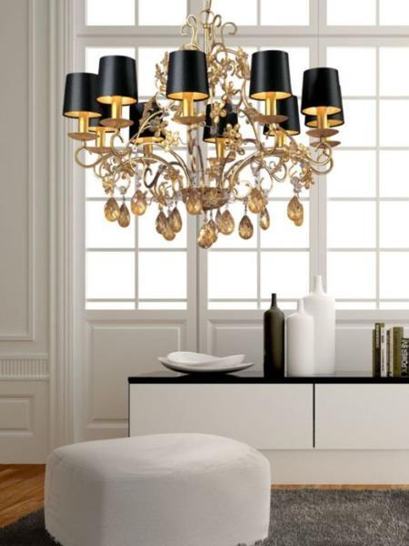 black and white room decor with large chandelier and black lamp shades