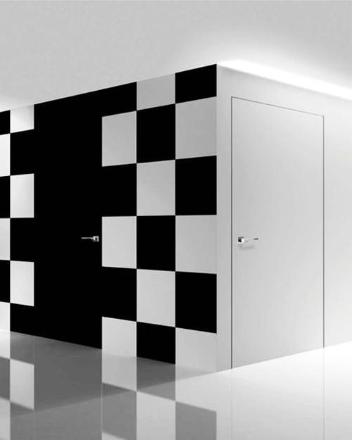 Accent Wall Design With Hidden Black And White Painted Interior Doors
