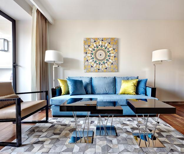 Bright And Ious Living Room Design With Modern Sofa In Light Blue Color