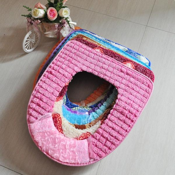 soft fabric toilet seat pads in various colors and designs