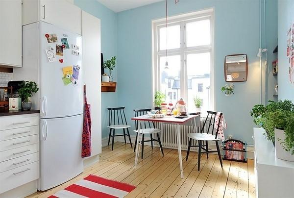 White Countertops And Painted Blue Kitchen Cabinets