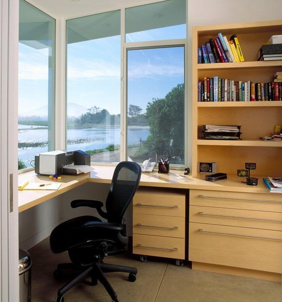 Small Home Office Design With Large Windows And Built In Furniture