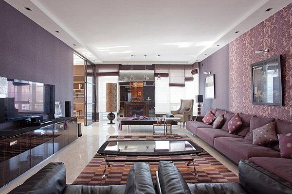 Colorful Living Room Design With Purple Sofa And Red Floor Rug