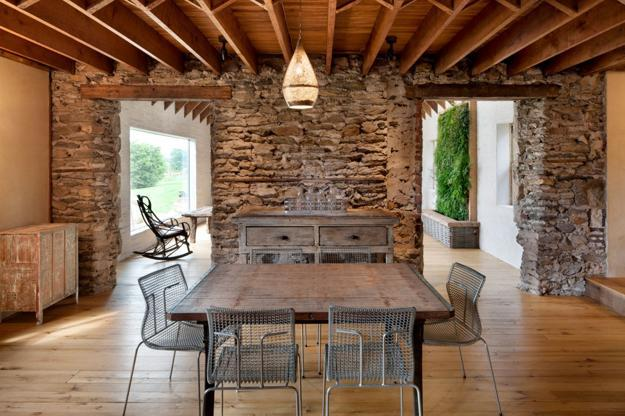 Rustic Wood Furniture Antique Stone Wall And Exposed Ceiling Beams