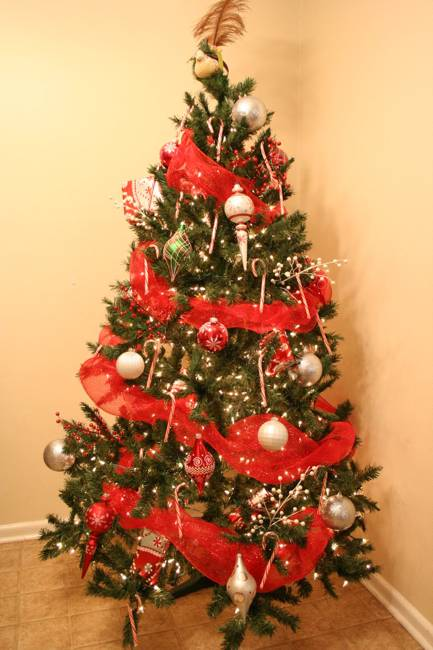 red christmas tree decorations and ribbons