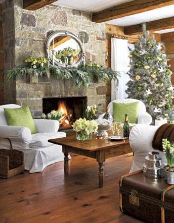 Stone Fireplace Decorated With Green Christmas Garland And Flowers