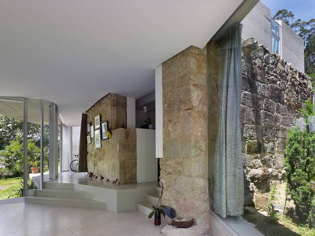 modern house design celebrating old stone walls and contemporary