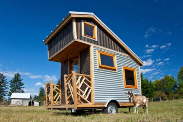 small home on wheels with wooden interior design