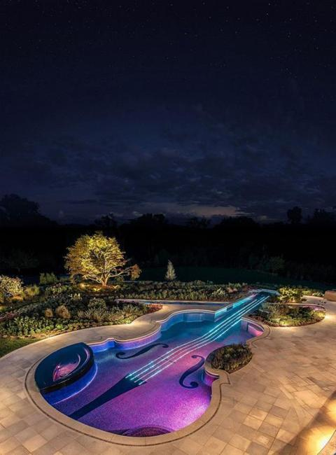 water features with outdoor lights, creative backyard designs