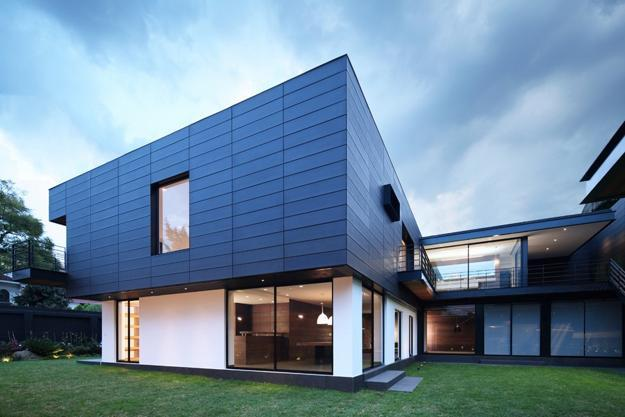 Contemporary house design with exterior ceramic panels and - Exterior materials for buildings ...