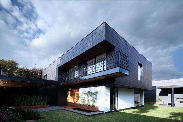 Contemporary House Design with Exterior Ceramic Panels and Wood Decor