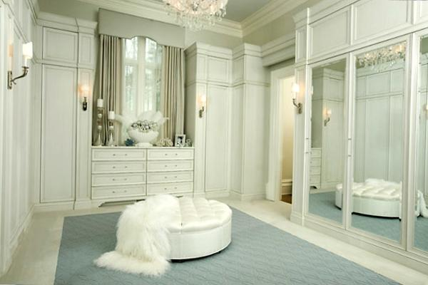 White Walk In Closet Design With Large Wall Mirrors And Ottoman