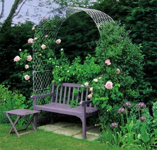 Ordinaire Metal Arbor With Flowering Plants And Wooden Bench