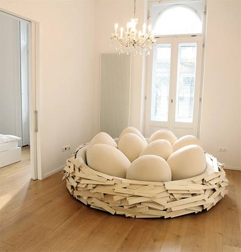 Nest Like Bed With Colorful Decorative Pillows In Egg Shape