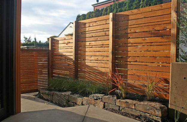 25 Beautiful Fence Designs to Improve and Accentuate Yard ... on Backyard Fence Landscaping Ideas id=51715