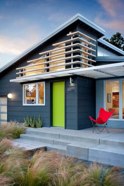 contemporary home with modern exterior, green and red accents