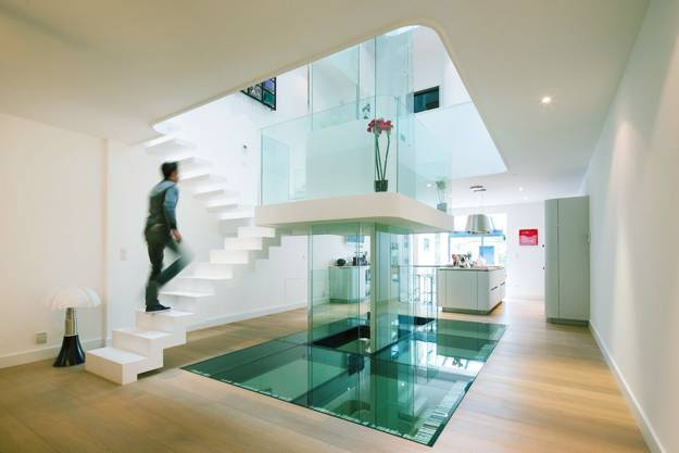 Urban House Design Enhanced By Decorating With Glass And Bright Pink