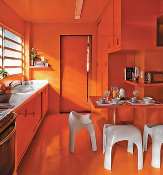Orange Kitchen Room With White Cabinets Stock Image