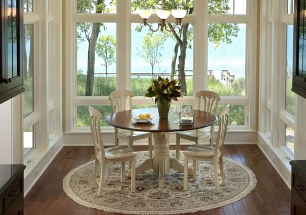 Small Dining Room Design With Large Windows, Round Dining Table, Wooden  Chairs Round Floor Rug With Floral Designs