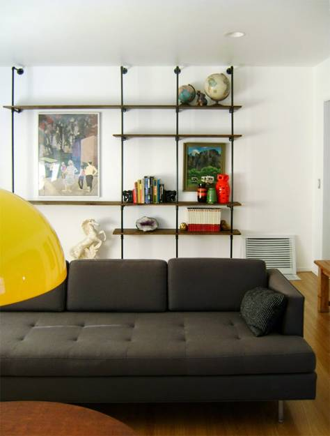 wall decoration with diy shelving unit created with pipes and wooden shelves