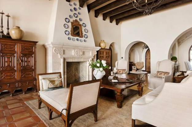 Outdoor living spaces in Spanish style, ceramic tile patio with gallery arches
