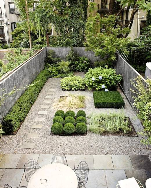 Small Garden Design With Stone Patio And Outdoor Seating Area
