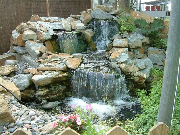22 Beautiful Waterfalls for Natural Backyard and Front ... on Front Yard Waterfall Ideas id=90294