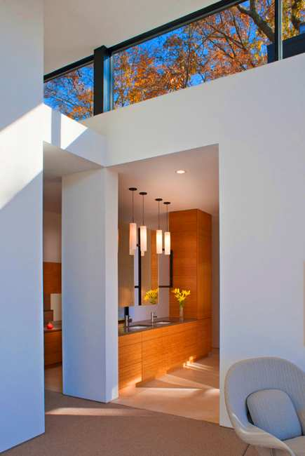 modern rooms with large windows and beautiful views of fall leaves