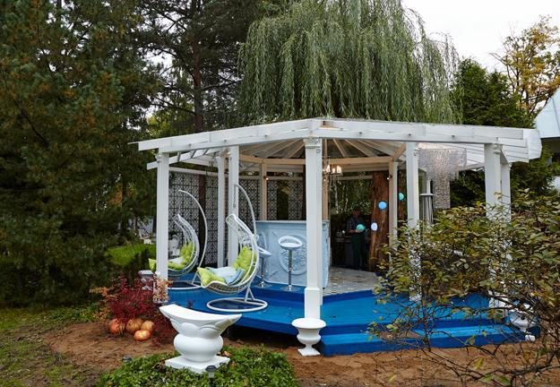 yard landscaping with wooden gazebo in vintage style