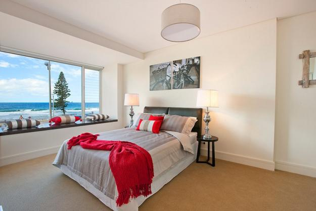 modern bedroom design and decor ideas in neutral colors with red accents