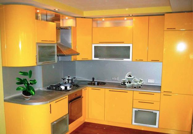 Contemporary Kitchen Design With Yellow Cabinets Transpa Doors And Accent Lighting