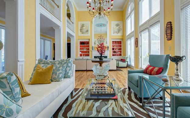 Living Room Design In Yellow And Blue Colors With Red Accents