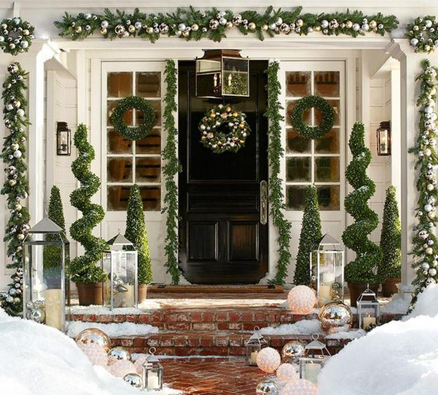 Evergreen Garland, Topiary Plants And Door Wreath With Christmas Lights