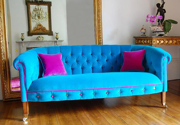 Modern Sofa In Turquoise Blue Color With Pink Pillows