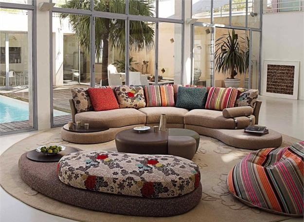 Colorful Curved Sofa And Ottomans With Decorating Pillows In Various Colors