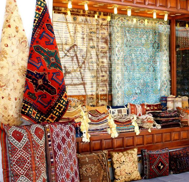 oriental interior decorating with textiles, floor rugs and decorative fabrics